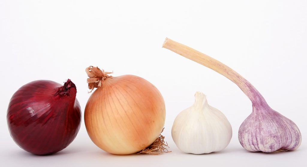 Onions and garlic on a table